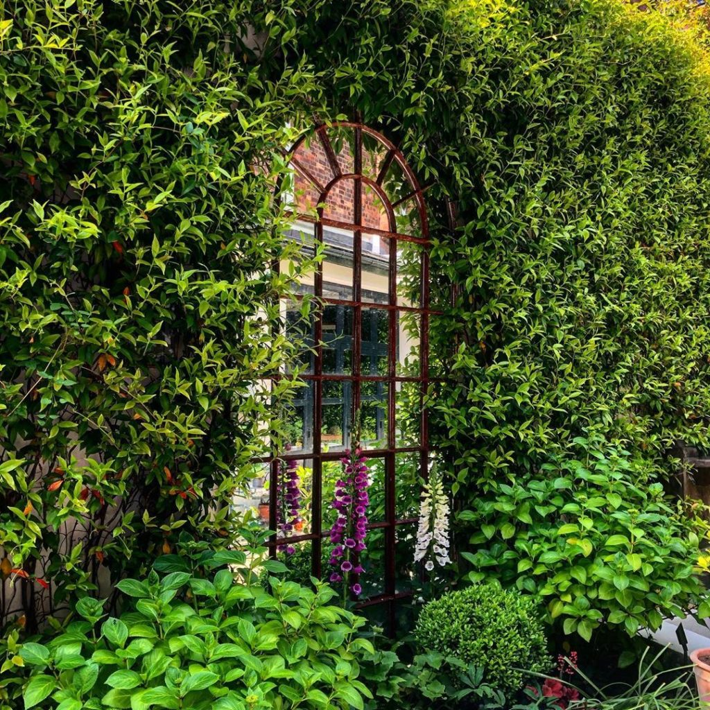 Mirror mirror in the wall...I make this lush oasis of a tiny London garden that ...