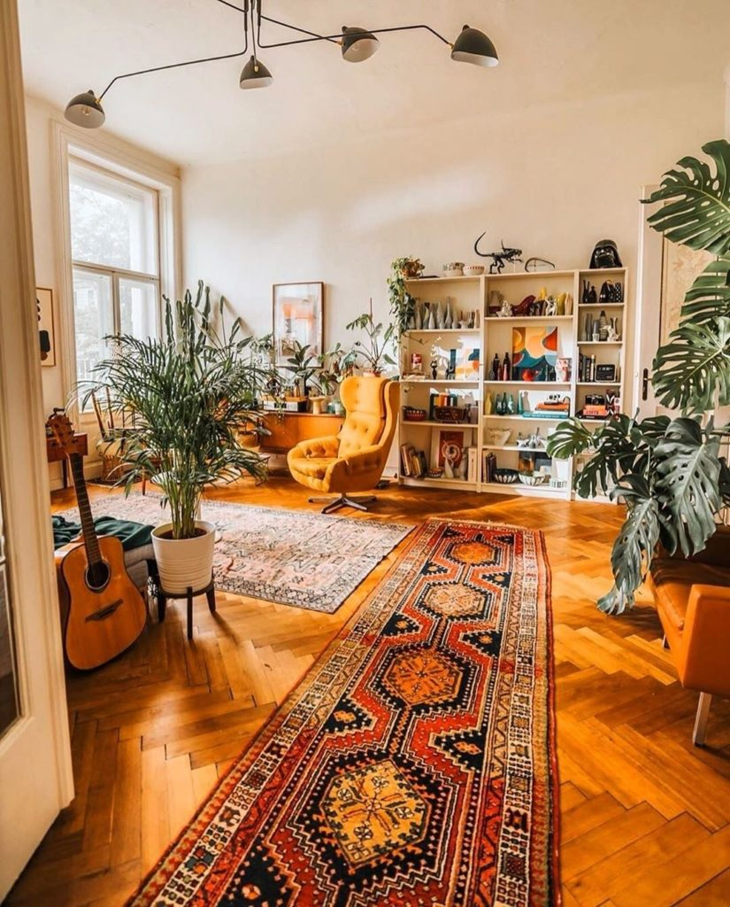 Best way to cozy up a big space: patterned rugs and lots of plants. Design goals...