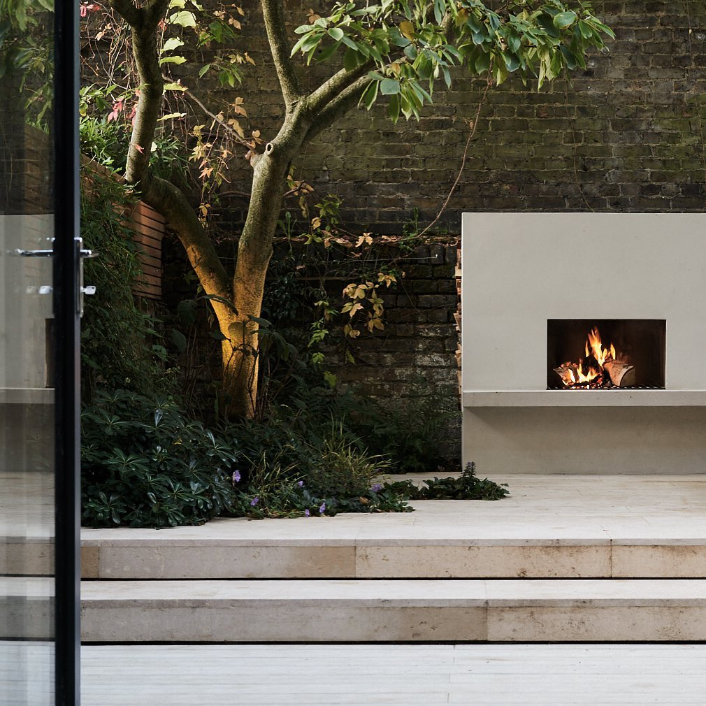 On fire  An outdoor fireplace and ambient lighting on this recently completed pr...