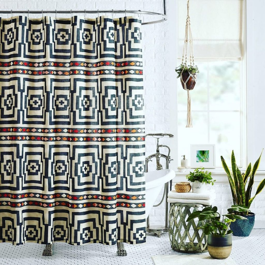 Your favorite quilts are now also shower curtains!  time to all alllll jungalici...