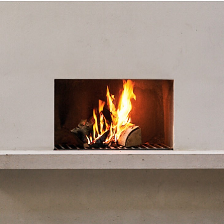 An #outdoorfireplace on a recent London project, perfect for staying warm on #wi...