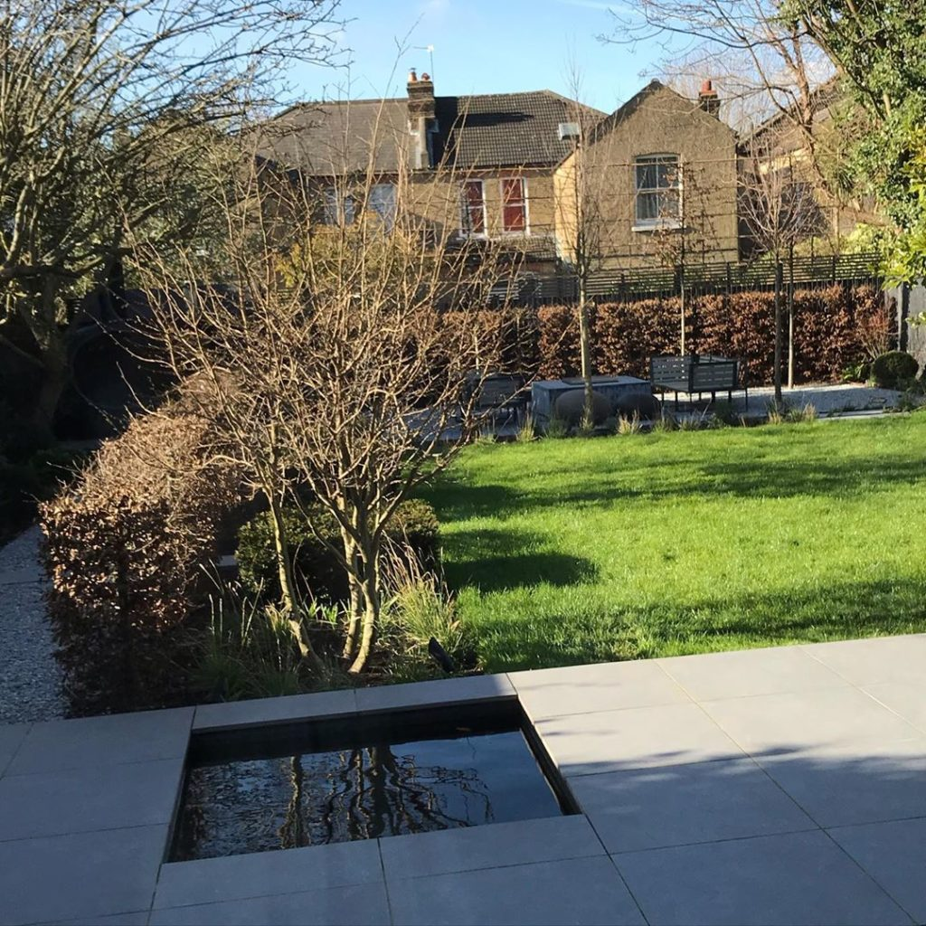 #winter #sunshine cheering up a #newlyfinished #towngarden #hedges and #trees in...