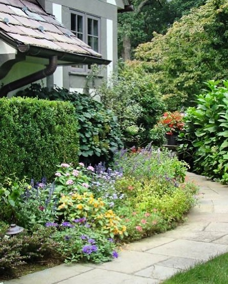 Garden Design Tip: To create a cottage garden feel, use a curving path to invite...